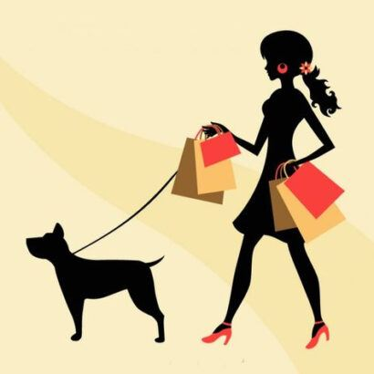 Woman carrying shopping bags and walking dog