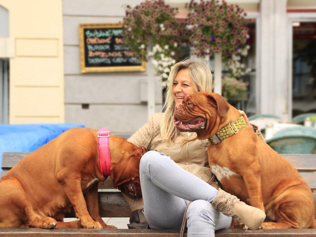 Woman on bench with dogs
